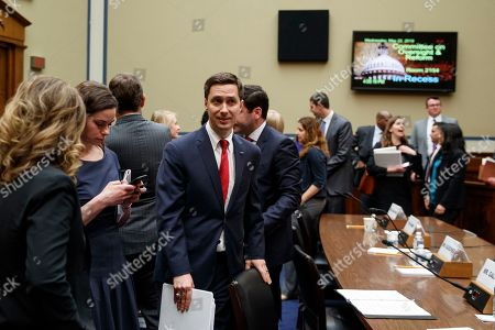 """Twitter Public Policy Manager Kevin Kane walks from the hearing room during a break in testimony on Capitol Hill in Washington, during the House Oversight and Reform National Security subcommittee hearing on """"Securing U.S. Election Infrastructure and Protecting Political Discourse"""
