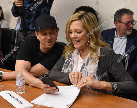 Jeff Fischer and Wendy Schaal attend the 300th episode table read and cake cutting celebration