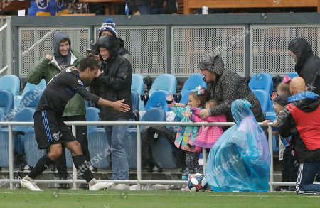 Stock Picture of San Jose Earthquakes forward Chris Wondolowski, left, celebrates with family after scoring a goal against the Chicago Fire during the second half of an MLS soccer match in San Jose, Calif., . Wondolowski scored four times to pass Landon Donovan for most career MLS goals