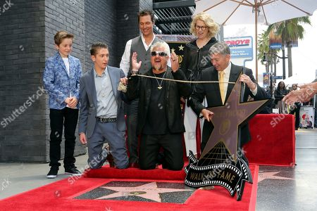 Ryder Fieri, Hunter Fieri, Matthew McConaughey, Guy Fieri, Kathleen Finch, Leron Gubler. Ryder Fieri, from left, Hunter Fieri, Matthew McConaughey, Guy Fieri, Kathleen Finch and Leron Gubler unveil a star during a ceremony honoring Fieri with a star at the Hollywood Walk of Fame, in Los Angeles