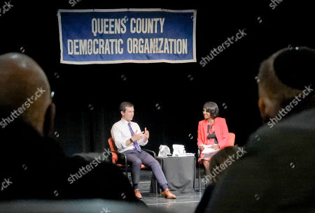 """Stock Image of Democratic presidential candidate Mayor Pete Buttigieg, left, South Bend, Indiana, speaks with NY1 news anchor Cheryl Wills, during the Queens Democratic party's first in a series of """"presidential fireside chat""""-- a town hall forum meant to bring candidates before the country's most diverse county, at LaGuardia Community College in New York"""