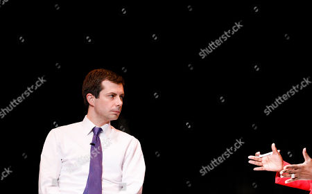 Stock Picture of Democratic presidential candidate Mayor Pete Buttigieg, of South Bend, Indiana, talks with television news anchor Cheryl Wills (R) during an event organized by the Queens County Democratic Organization at LaGuardia Community College in Long Island City, New York, USA, 22 May 2019.