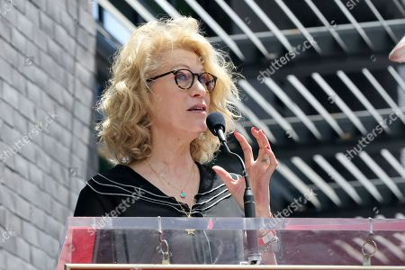 Kathleen Finch speaks at a ceremony honoring Guy Fieri with a star at the Hollywood Walk of Fame, in Los Angeles