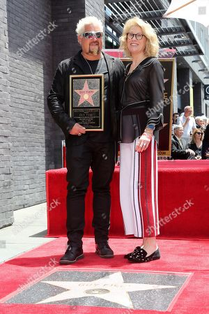 Guy Fieri, Kathleen Finch. Guy Fieri, left, and Kathleen Finch pose for the press as he holds a star miniaturette following a ceremony honoring Guy Fieri with a star at the Hollywood Walk of Fame, in Los Angeles