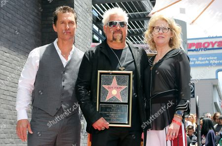 Matthew McConaughey, Guy Fieri, Kathleen Finch. Matthew McConaughey, from left, Guy Fieri and Kathleen Finch pose with a star miniaturette following a ceremony honoring Guy Fieri with a star at the Hollywood Walk of Fame, in Los Angeles