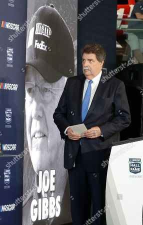 Stock Picture of Mike Helton, Joe Gibbs. NASCAR vice chairman Mike Helton watches a video after naming team owner Joe Gibbs a member of the NASCAR Hall of Fame, in Charlotte, N.C