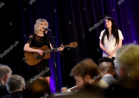 Stock Image of Anais Mitchell, Rachel Chavkin. Singer-songwriter Anais Mitchell, left, and director Rachel Chavkin, of Hadestown, perform during the 108th Annual Broadway Association Awards Luncheon, at the New York Marriott Marquis