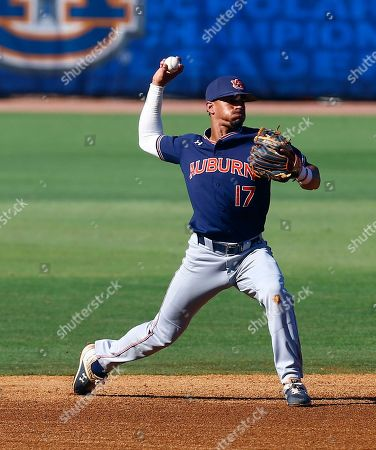 Auburn shortstop Will Holland throws to first for the out on Vanderbilt's Austin Martin during the first inning of a Southeastern Conference tournament NCAA college baseball game, in Hoover, Ala