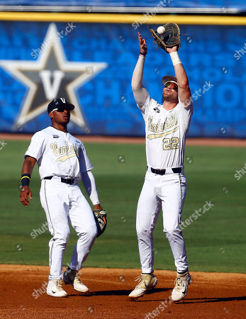Vanderbilt first baseman Julian Infante (22) catches a pop fly, next to second baseman Harrison Ray (2), for the out on Auburn's Will Holland during the first inning of a Southeastern Conference tournament NCAA college baseball game, in Hoover, Ala