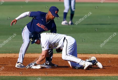 Vanderbilt's JJ Bleday (51) beats the tag from Auburn shortstop Will Holland (17) as he slides into second base during the first inning of a Southeastern Conference tournament NCAA college baseball game, in Hoover, Ala