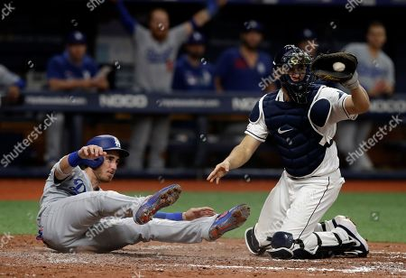 Cody Bellinger, Travis d'Arnaud. Tampa Bay Rays catcher Travis d'Arnaud, right, shows the ball to home plate umpire Bill Miller after tagging out Los Angeles Dodgers' Cody Bellinger during the sixth inning of a baseball game, in St. Petersburg, Fla