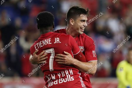 New York Red Bulls forward Brian White, right, hugs New York Red Bulls midfielder Derrick Etienne Jr. after scoring a goal during the first half of an MLS soccer match, in Harrison, N.J. The match ended in a 2-2 draw