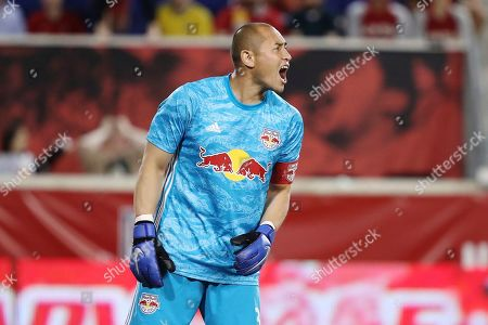 New York Red Bulls goalkeeper Luis Robles yells out to his teammates during the second half of an MLS soccer match against the Vancouver Whitecaps, in Harrison, N.J. The match ended in a 2-2 draw