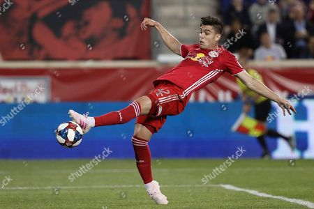 New York Red Bulls forward Brian White attempts to control the ball during the first half of an MLS soccer match against the Vancouver Whitecaps, in Harrison, N.J. The match ended in a 2-2 draw