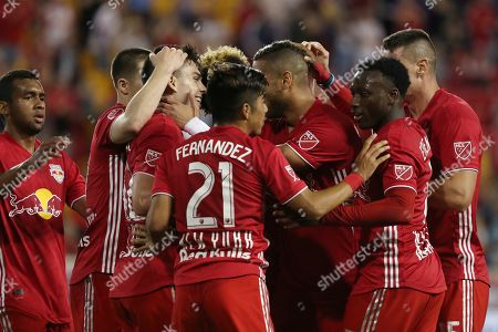The New York Red Bulls celebrate after New York Red Bulls forward Brian White scored a goal during the first half of an MLS soccer match against the Vancouver Whitecaps, in Harrison, N.J. The match ended in a 2-2 draw