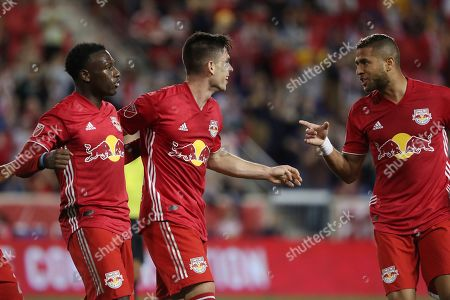 From left, New York Red Bulls midfielder Derrick Etienne Jr., New York Red Bulls forward Brian White, and New York Red Bulls defender Amro Tarek celebrate after Brian White scored a goal during the first half of an MLS soccer match against the Vancouver Whitecaps, in Harrison, N.J. The match ended in a 2-2 draw