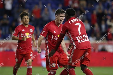 New York Red Bulls forward Brian White, center, reacts after scoring a goal during the first half of an MLS soccer match against the Vancouver Whitecaps, in Harrison, N.J