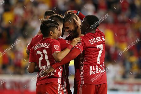 The New York Red Bulls celebrate after New York Red Bulls forward Brian White scored a goal during the first half of an MLS soccer match against the Vancouver Whitecaps, in Harrison, N.J