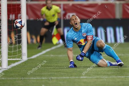 New York Red Bulls goalkeeper Luis Robles reacts after conceding a goal from a penalty shot during the second half of an MLS soccer match against the Vancouver Whitecaps, in Harrison, N.J. The match ended in a 2-2 draw