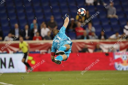 New York Red Bulls goalkeeper Luis Robles leaps to make a save during the second half of an MLS soccer match against the Vancouver Whitecaps, in Harrison, N.J. The match ended in a 2-2 draw