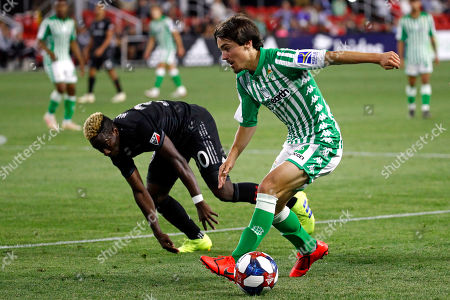 Akeem Ward, Sergio Canales. Real Betis midfielder Sergio Canales, right, drives past D.C. United defender Akeem Ward during the second half of a friendly soccer match, in Washington