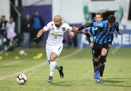 Stock Image of Nestor Canelon (L) of Caracas FC in action against Martin Rivas (R) of Liverpool during the Copa Sudamericana second phase soccer match between Liverpool of Uruguay and Caracas FC of Venezuela, at the Luis Franzini Stadium in Montevideo, Uruguay, 22 May 2019.
