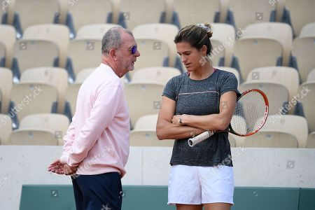 Amelie Mauresmo and Loic Courteaux during practice