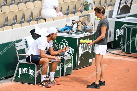 Amelie Mauresmo and Lucas Pouille during practice