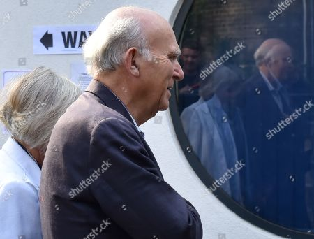 Vince Cable with his wife Rachel Smith, leader of the Liberal Democrats arrives at the polling station in Twickenham to cast his vote in the European elections.