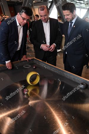 The German CDU/CSU top candidate for the upcoming European Parliament Elections, European People's Party (EPP) chairman Manfred Weber (C) and mayor of Warsaw Rafal Trzaskowski (R) while exploring the Copernicus Science Center in Warsaw, Poland 23 May 2019.