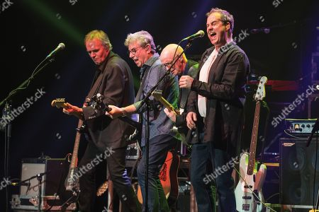 London United Kingdom - April 13: Rick Fenn Graham Gouldman Keith Hayman And Mick Wilson Of Rock Group 10cc Performing Live On Stage At The Palladium In London On April 13