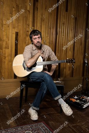 London United Kingdom - August 20: Portrait Of English Musician Graham Coxon Photographed With His Yamaha Ls26 Acoustic Guitar At Konk Studios In London On August 20 2018. Coxon Is Best Known As A Singer-songwriter And Guitarist With Indie Rock Group Blur