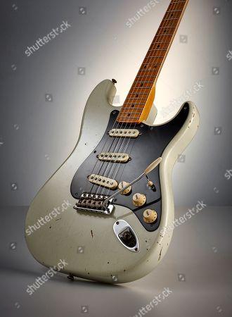A Fender Custom Shop Eu Master Design '56 Stratocaster Electric Guitar With A '55 Desert Tan Relic Finish