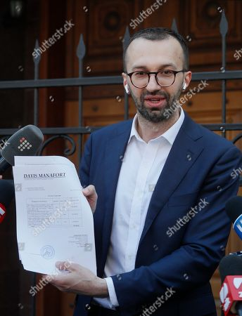 Ukrainian lawmaker Serhiy Leshchenko shows to journalists the originals of documents, which was returned from USA by the FBI after ending of Manafort case investigations, before his visit to Prosecutor General Office in Kiev, Ukraine, 23 May 2019. Leshchenko said US political consultant Paul Manafort, journalist Larry King, and Svoboda Party in Ukraine received money from the so-called 'black ledgers' of the pro-Yanukovych Party of Regions during Presidential election campaign in 2010. On 14 May 2019, Ukrainian Prosecutor General Yuriy Lutsenko accused Leshchenko of interfering in the American elections in 2016 with the aim of helping one of the presidential candidates because of disclossed data on Manafort, who at the time when such data were disseminated, led Donald Trump's campaign headquarters.