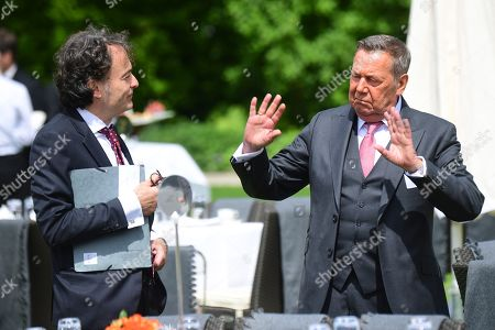 Journalist Giovanni di Lorenzo (L) and singer Roland Kaiser talk during a garden party at Bellevue Pallace on the occasion of the 70th anniversary of the German constitution (Grundgesetz) in Berlin, Germany, 23 May 2019. The German constituion (Grundgesetz) was announced on 23 May 1949.