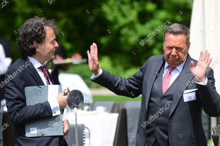 Journalist Giovanni di Lorenzo (L) and singer Roland Kaiser (R) talk during a garden party at Bellevue Pallace on the occasion of the 70th anniversary of the German constitution (Grundgesetz) in Berlin, Germany, 23 May 2019. The German constituion (Grundgesetz) was announced on 23 May 1949.