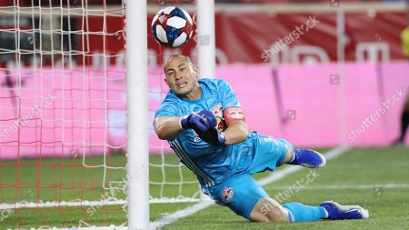 New York Red Bulls goalkeeper Luis Robles makes a save during the second half of an MLS soccer match against the Vancouver Whitecaps, in Harrison, N.J. The match ended in a 2-2 draw