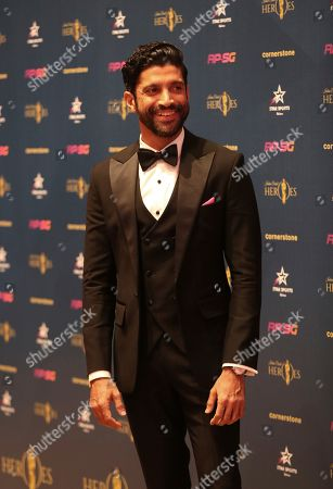 Bollywood filmmaker and actor Farhan Akhtar poses as he arrives for an Indian Cricket Heroes red carpet event, ahead of the Cricket World Cup in London, . The Cricket World Cup starts on Thursday May 30