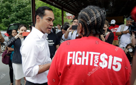 Presidential candidate and former U.S. Department of Housing and Urban Development Julian Castro speaks with a supporter prior to rallying with McDonald's employees and other activists demanding fairer pay, better working conditions, and the right to unionize in Durham, N.C