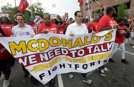 Presidential candidate and former U.S. Department of Housing and Urban Development Julian Castro, second from right, rallies with McDonald's employees and other activists demanding fairer pay, better working conditions, and the right to unionize in Durham, N.C