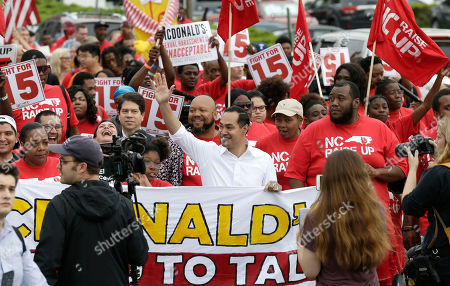 Stock Image of Presidential candidate and former U.S. Department of Housing and Urban Development Julian Castro rallies with McDonald's employees and other activists demanding fairer pay, better working conditions, and the right to unionize in Durham, N.C