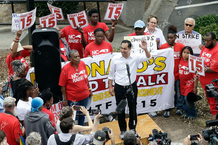 Stock Photo of Presidential candidate and former U.S. Department of Housing and Urban Development Julian Castro rallies with McDonald's employees and other activists demanding fairer pay, better working conditions, and the right to unionize in Durham, N.C