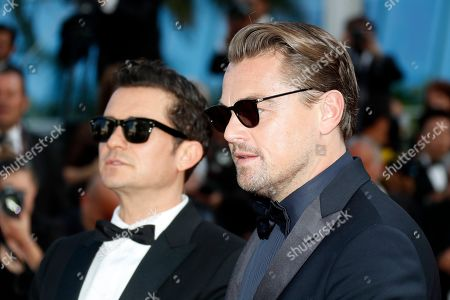 Stock Picture of Leonardo di Caprio and British actor Orlando Bloom arrives for the screening of 'Il traditore' (The Traitor) during the 72nd annual Cannes Film Festival, in Cannes, France, 23 May 2019. The movie is presented in the Official Competition of the festival which runs from 14 to 25 May.