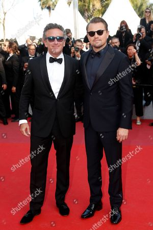Crew from the movie 'And we go green', Alejandro Agag (L) and Leonardo DiCaprio(R) arrive for the screening of 'Il traditore' (The Traitor) during the 72nd annual Cannes Film Festival, in Cannes, France, 23 May 2019. The movie is presented in the Official Competition of the festival which runs from 14 to 25 May.