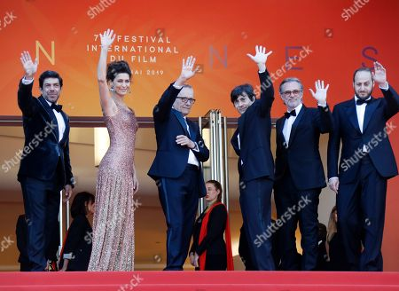 Pierfrancesco Favino, Brazilian actress Maria Fernanda Candido, Italian director Marco Bellocchio, Italian actor Luigi Lo Cascio, a guest and Italian actor Fausto Russo Alesi arrive for the screening of 'Il traditore' (The Traitor) during the 72nd annual Cannes Film Festival, in Cannes, France, 23 May 2019. The movie is presented in the Official Competition of the festival which runs from 14 to 25 May.