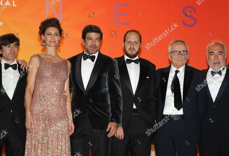 Luigi Lo Cascio, Brazilian actress Maria Fernanda Candido, Italian actor Pierfrancesco Favino, Italian actor Fausto Russo Alesi, Italian director Marco Bellocchio and a guest leave after the screening of 'Il traditore' (The Traitor) during the 72nd annual Cannes Film Festival, in Cannes, France, 23 May 2019. The movie is presented in the Official Competition of the festival which runs from 14 to 25 May.