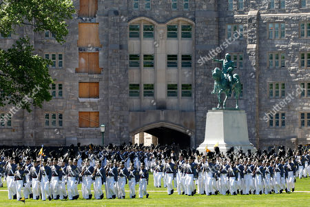 Members of the senior class march past a statue of George Washington during Parade Day at the U.S. Military Academy in West Point, N.Y. West Point boosted efforts to recruit women and blacks after being told to diversify in 2013 by then-Army Chief of Staff Gen. Raymond Odierno