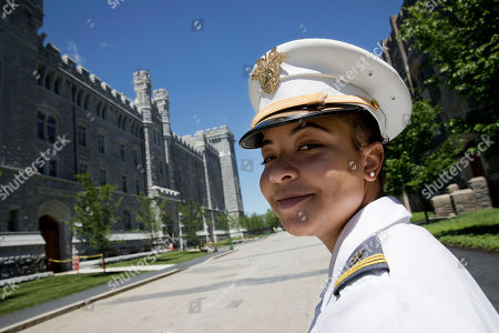 """Gabrielle Young, of Hopkins, South Carolina, poses at the U.S. Military Academy in West Point, N.Y. """"I feel like in some ways that I do have to prove myself a little bit more, prove that I belong here. And even a classmate told me, I think our freshman year, that I only got in because I was a black female,"""" said Young, one of the few in her class chosen for medical school"""
