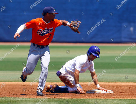LSU's Josh Smith (4) beats the throw to Auburn shortstop Will Holland (17) as he slides into second during the first inning of an NCAA college baseball game at the Southeastern Conference tournament, in Hoover, Ala