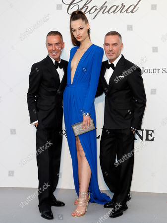 Dean and Dan Caten and Croatian model Faretta (C) attend the Cinema Against AIDS amfAR gala 2019 held at the Hotel du Cap, Eden Roc in Cap d'Antibes, France, 23 May 2019, within the scope of the 72nd annual Cannes Film Festival that runs from 14 to 25 May.